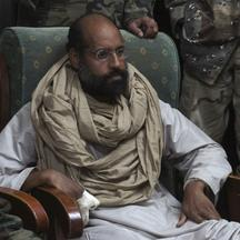 'Saif al-Islam is seen after his capture, in the custody of revolutionary fighters in Obari, Libya November 19, 2011. Libya\'s prime minister-designate said Saif al-Islam would receive a fair trial in