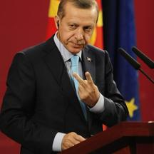 \'Turkey\'s Prime Minister Tayyip Erdogan gestures during a news conference with his Macedonian counterpart Nikola Gruevski in Skopje September 29, 2011. Turkey\'s Prime Minister Erdogan is on a two-d