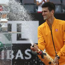 Novak Djokovic of Serbia sprays champagne after winning the final match over Roger Federer of Switzerland at the Rome Open tennis tournament in Rome, Italy, May 17, 2015. REUTERS/Stefano Rellandini