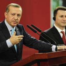 'Turkey\'s Prime Minister Tayyip Erdogan (L) gestures during a news conference with his Macedonian counterpart Nikola Gruevski in Skopje September 29, 2011. Turkey\'s Prime Minister Erdogan is on a tw