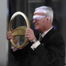 Volkswagen AG's Chief Executive Officer Martin Winterkorn poses for photographers as he arrives for the