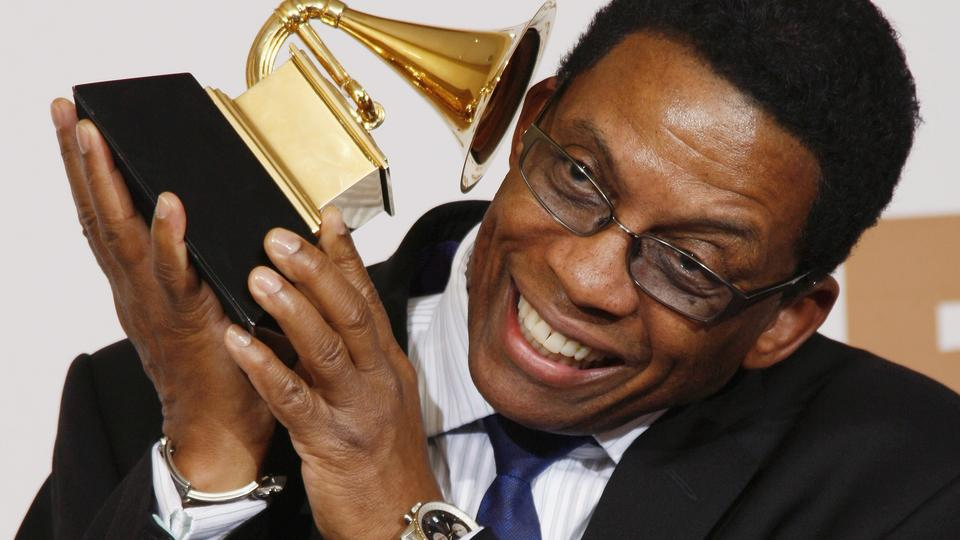 Musician Herbie Hancock poses with his award for Best Contemporary Jazz Album for