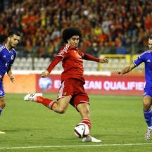 Belgium's Marouane Fellaini (C) kicks the ball past Bosnia's Emir Spahic (L) and Ognjen Vranjes during their Euro 2016 qualification match at the King Baudouin stadium in Brussels, Belgium September 3, 2015. REUTERS/Yves Herman
