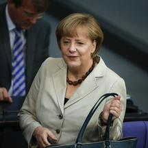 'German Chancellor Angela Merkel arrives at the the lower house of parliament, the Bundestag, in Berlin to deliver a government policy statement on her European policies, June 27, 2013.  REUTERS/Thoma