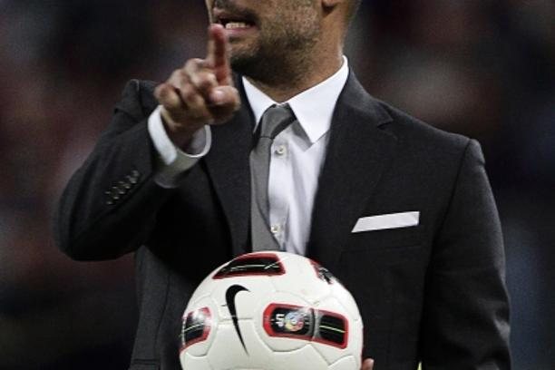 'Barcelona\'s coach Pep Guardiola gestures during their Spanish first division soccer match against Almeria at Camp Nou stadium in Barcelona April 9, 2011. REUTERS/ Albert Gea (SPAIN - Tags: SPORT SOC