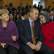 \'German Chancellor Angela Merkel (L), Turkey\'s Prime Minister Recep Tayyip Erdogan (C) and his wife Emine (R) attend a a ceremony to celebrate 50 years of Turkish guest workers in Germany on Novembe