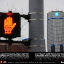 'A pedestrian traffic light indicates red near the headquarter office highrise of US car giant General Motors (GM) in Detroit, USA, 13 January 2013. Photo: Uli Deck/DPA/PIXSELL'
